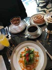 Choice of brunch: Strawberry-swirl yogurt & Granola; Avocado on Focaccia, Raisin Brioche Pastry, Mimosa & Coffee